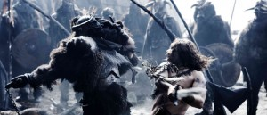 Ghost (Karl Urban) strikes a fatal blow to a Viking warrior. Photo Credit: Doug Curran