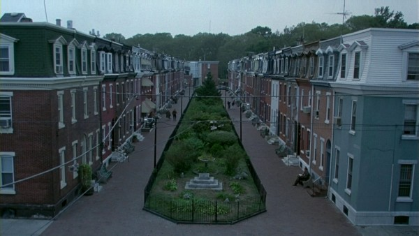 The two rows of houses and the greenery area in the middle form three sets of objects.