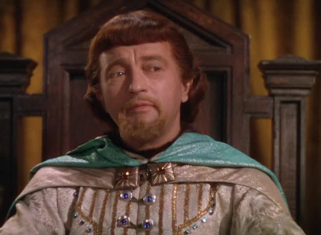 Claude Rains spiller Prince John, kongens maktsyke bror.