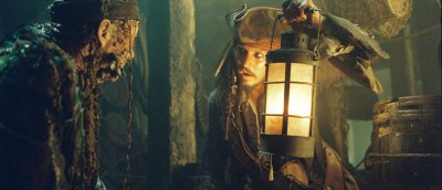 Pictured: Bootstrap Bill (STELLAN SKARSG≈RD) and Captain Jack Sparrow (JOHNNY DEPP) in a scene from PIRATES OF THE CARIBBEAN: DEAD MAN'S CHEST. Johnny Depp, Orlando Bloom and Keira Knightley reunite in Walt Disney Pictures', in association with Jerry Bruckheimer Films, PIRATES OF THE CARIBBEAN: DEAD MAN'S CHEST, an all new epic tale chronicling the further mis-adventures of Captain Jack Sparrow. Produced by Jerry Bruckheimer and directed by Gore Verbinski from a screenplay written by Ted Elliott & Terry Rossio, Captain Jack sets sail on an all new adventure - filled with more intrigue, more spectacular special effects and more comedy - 2006.