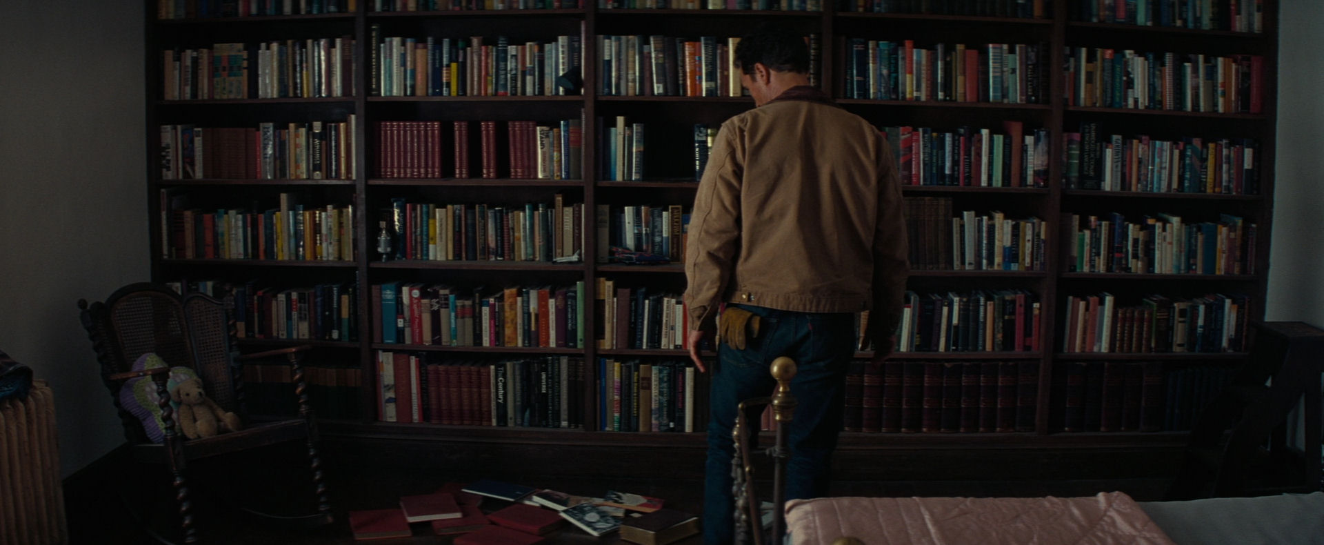 When The Ghost Pushed Books From Shelf In Early Stages Of Film Pitch Black Voids Arose Rows Almost As If A Foreshadowing